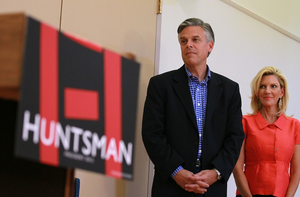 Former Utah governor and Republican presidential canididate Jon Huntsman looks on with his wife Mary Kaye during a town hall style meeting at the Kendal Retirement Community on October 11, 2011 in Hanover, New Hampshire.