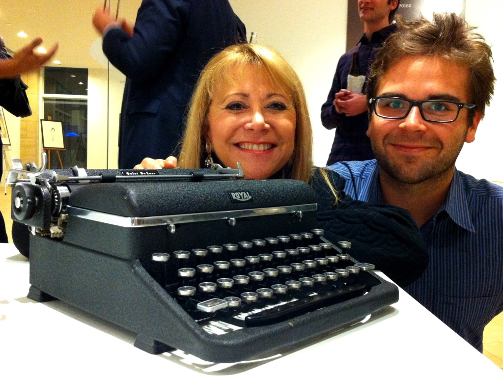 Laura Siegel Larson and Michael Larson, daughter and grandson of Jerry Siegel, writer/creator of Superman, with Siegel's typewriter at the Paley Center's exhibit of the Soboroff typewriter collection.