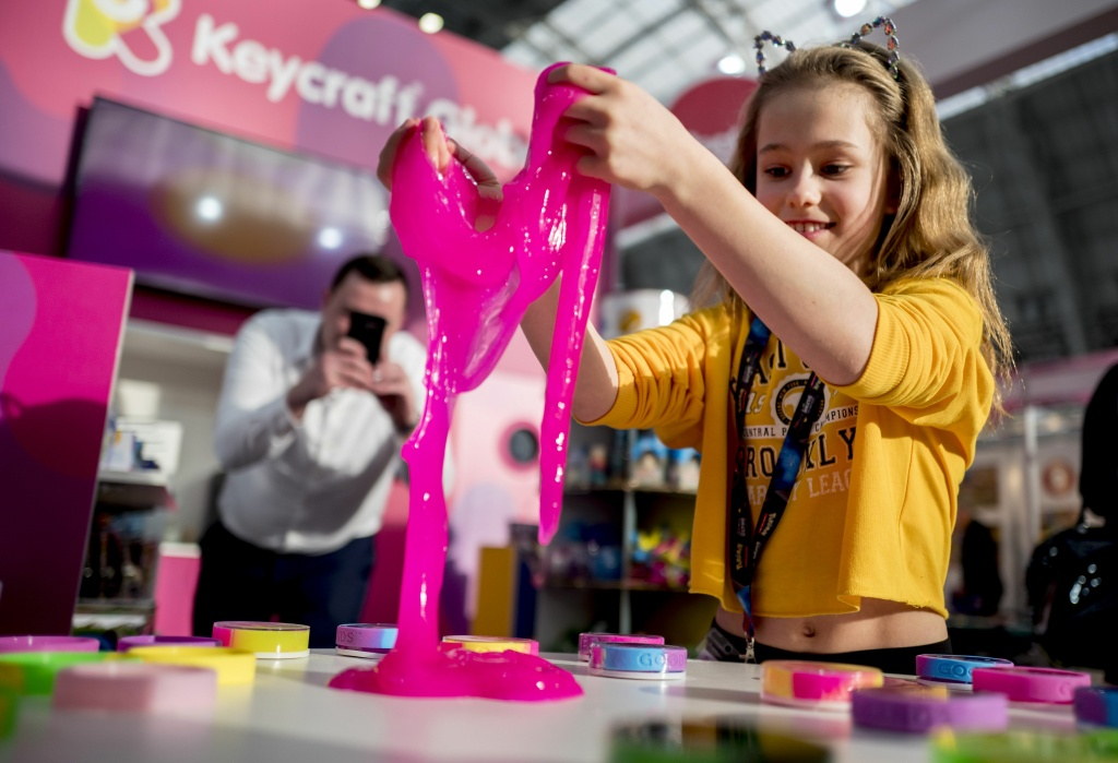 A child plays with Goobands slimes at the annual Toy Fair in London on January 23, 2018.