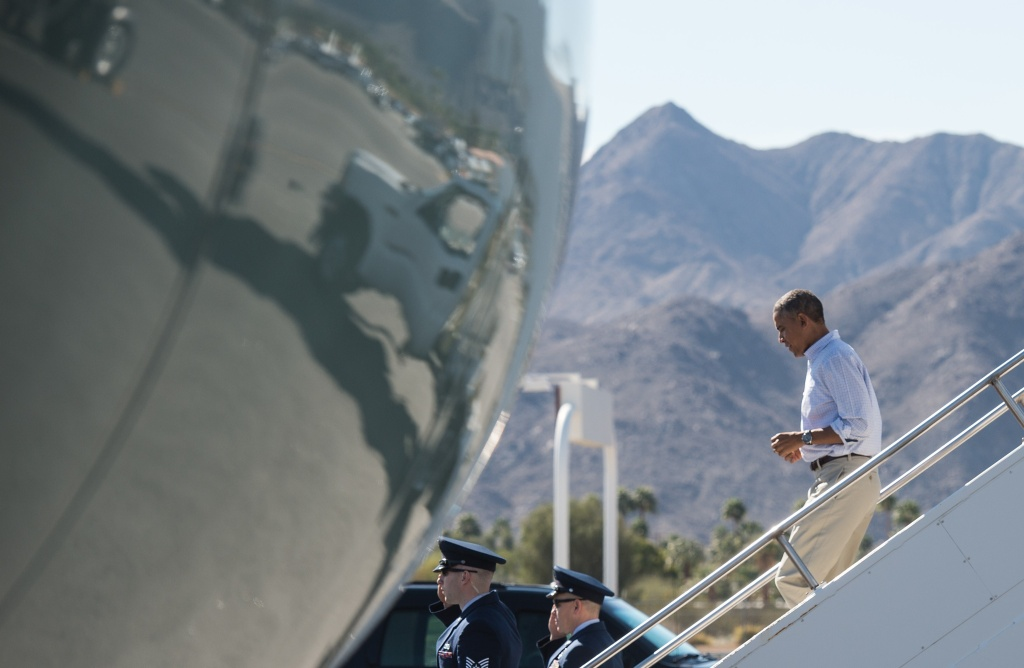 US President Barack Obama walks off Air Force One on February 14, 2015 as he arrives in Palm Springs, California where he will spend the Presidents Day weekend.