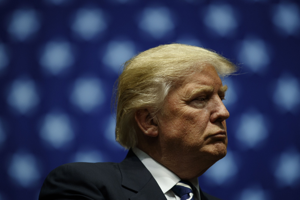 President-elect Donald Trump looks on during at the DeltaPlex Arena, December 9, 2016 in Grand Rapids, Michigan.