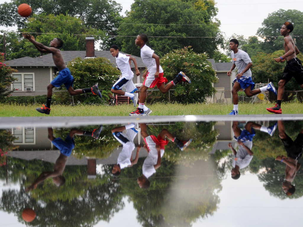 The CDC would be happy with these guys, who were playing in Birmingham, Ala., in July 2013. Teenage boys say basketball is their favorite activity.