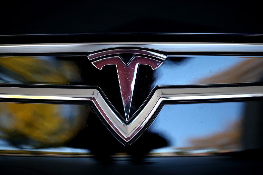 The Tesla logo is shown on the front of a new Tesla Model S car at a Tesla showroom on November 5, 2013 in Palo Alto, California.
