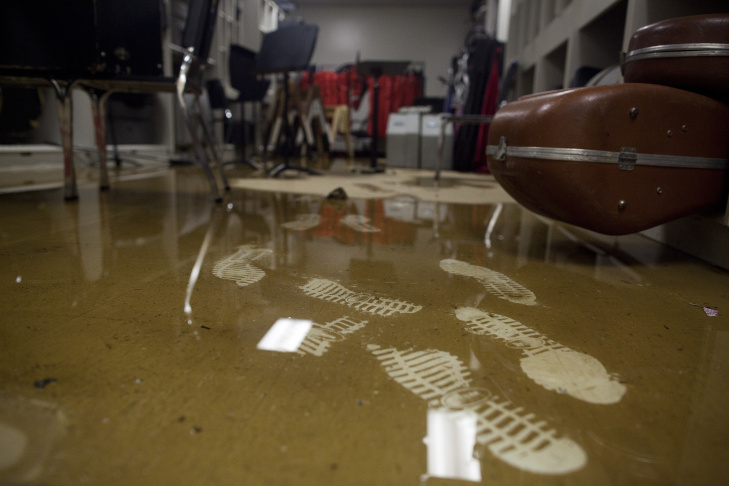 Water and silt fills a room that stores instruments for the Elsinore High School band after a flash flood inundated the campus Tuesday.