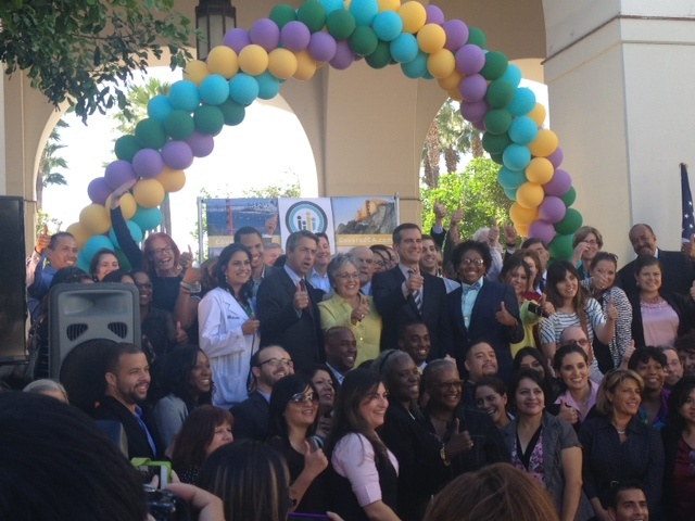 Mayor Eric Garcetti poses with celebrants at a kick off event for Covered California, the state's health insurance exchange.