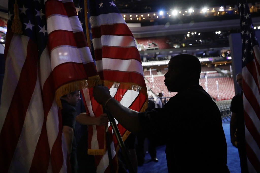 James Jackson carries flags during preparations before the start of the 2016 Democratic Convention, Monday, July 25, 2016, in Philadelphia. (AP Photo/John Locher)