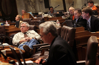 Wisconsin State representatives start to fade as they listen to arguments on one of the expected 200 amendments to Gov. Scott Walker's budget repair bill in the early morning hours on February 24, 2011 in Madison, Wisconsin.