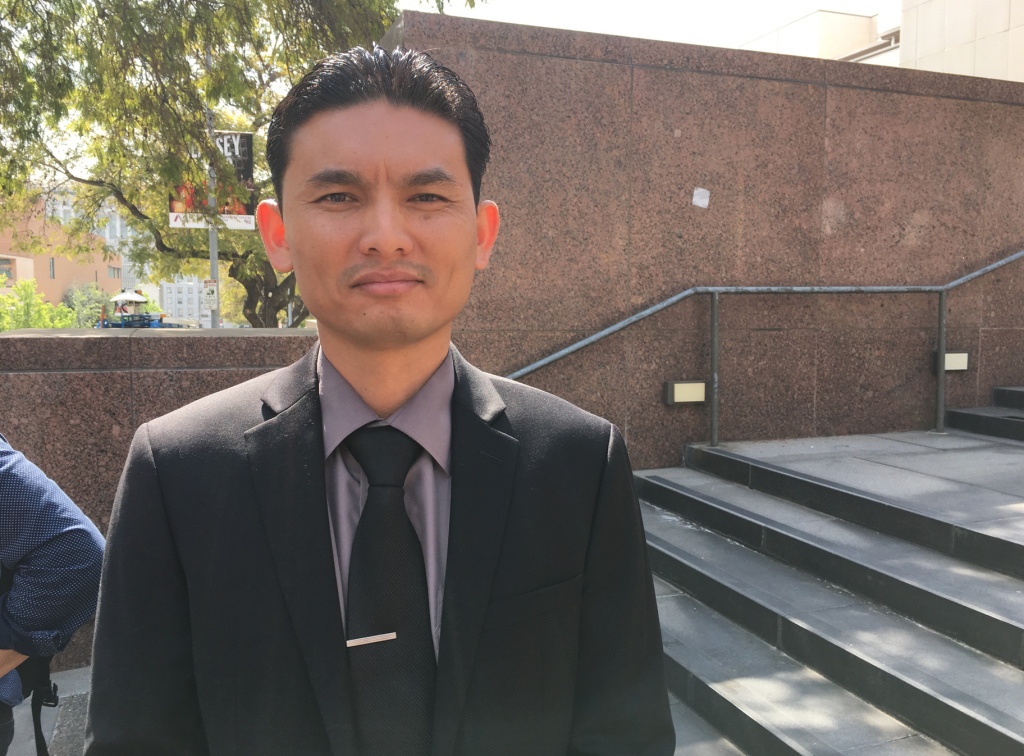 Phal Sok, 35, was among those who protested Tuesday against a proposal before the Los Angeles County Board of Supervisors to place limits on which immigrants can get legal help to fight deportation.