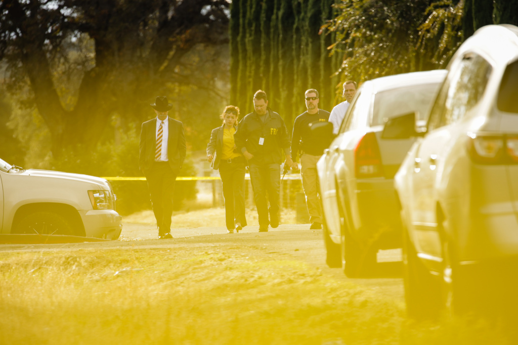 FBI agents are seen behind yellow crime scene tape outside Rancho Tehama Elementary School after a shooting in the morning on November 14, 2017.