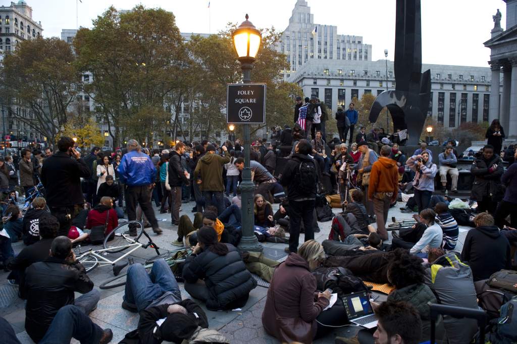 Occupy Wall Street protesters gather together at Foley Square in New York after being evicted from Zuccotti Park.