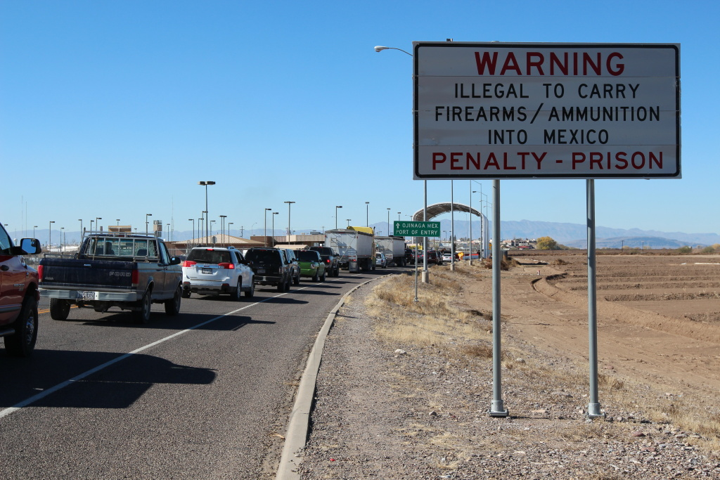 Passengers entering Ojinaga, Chihuahua stop before entering Mexico under a recently constructed metal canopy where they are questioned before leaving the United States.