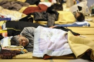 A survivor of the March 11 quake in Japan stays in a refugee shelter in a school in northeast Japan.