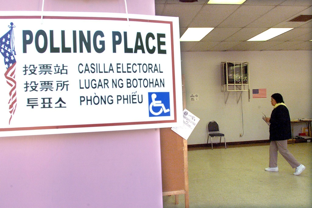 FILE PHOTO: A poster designating a polling station at a school in East Los Angeles in November 2000.