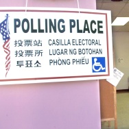 A poster designating a polling station at a school in East Los Angeles is written in seven languages.