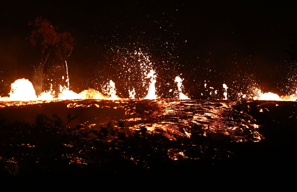 Lava erupts and flows from a Kilauea volcano fissure on Hawaii's Big Island on May 18, 2018 in Kapoho, Hawaii.