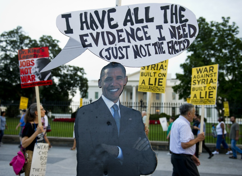 A cutout of US President Barack Obama stands on the sidewalk as demonstrators march in protest during a rally against a possible U.S. and allies attack on Syria in response to possible use of chemical weapons by the Assad government, in Lafayette Park in front of the White House in Washington, DC on August 29, 2013.
