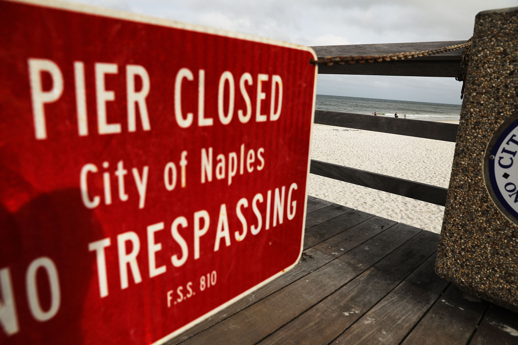 A sign announces the closure of the pier in Naples, Florida before the arrival of Hurricane Irma on September 9, 2017.