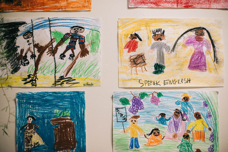 Drawings hang on the walls at Las Familias Del Pueblo.
