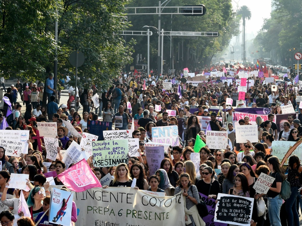 People take part in the commemoration of International Women's Day in Mexico City on March 8. The national public security department's statistics show that more than 41 percent of women over the age of 15 have experienced some sort of sexual violence.