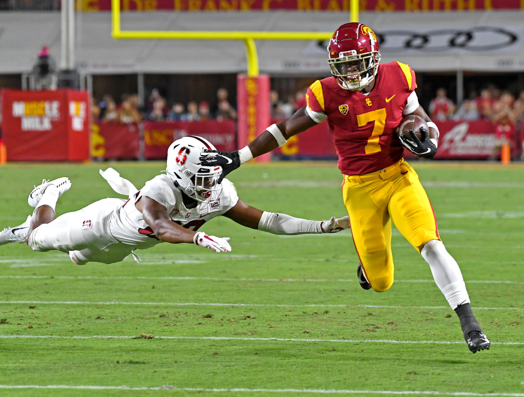 Cornerback Obi Eboh #22 of the Stanford Cardinal fails to catch running back Stephen Carr #7 of the USC Trojans as he heads into the end zone for a touch down in the first half of the game at the Los Angeles Memorial Coliseum on September 7, 2019 in Los Angeles, California.