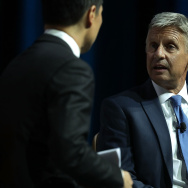 Libertarian presidential nominee Gary Johnson (R) speaks to moderator Richard Lui (L) of MSNBC during a 2016 Presidential Election Forum.