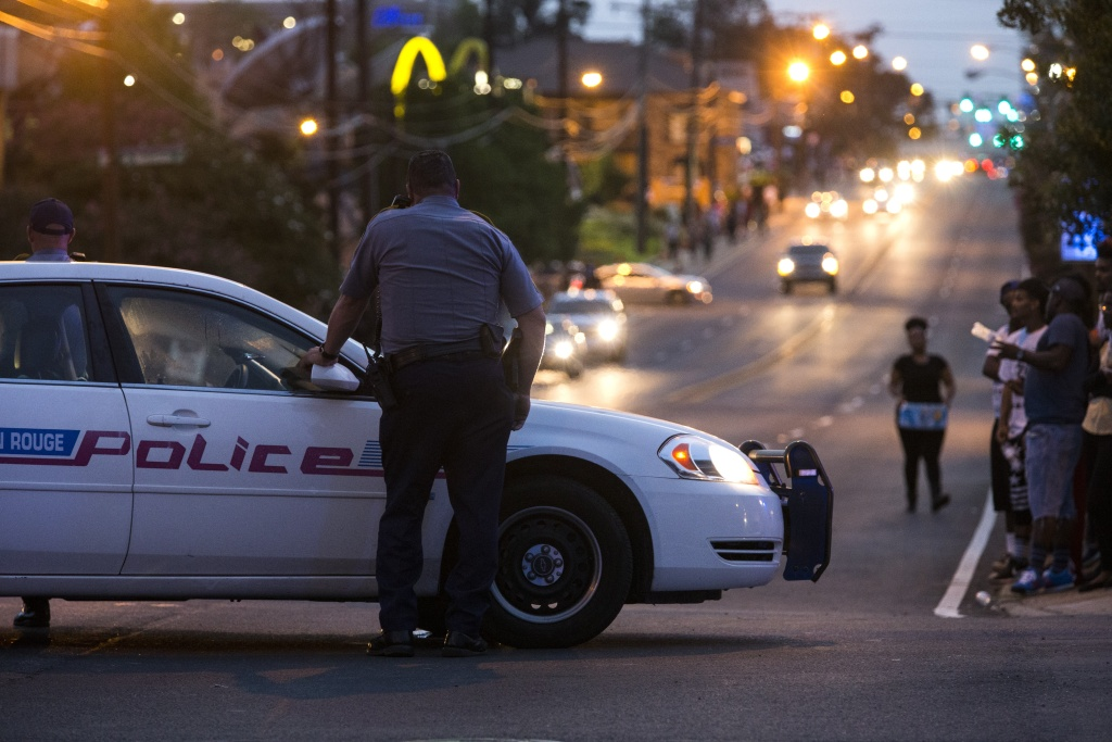Baton Rouge police redirect traffic away from a protest march that resulted in scores of arrests after a march on July 10, 2016 in Baton Rouge, Louisiana.