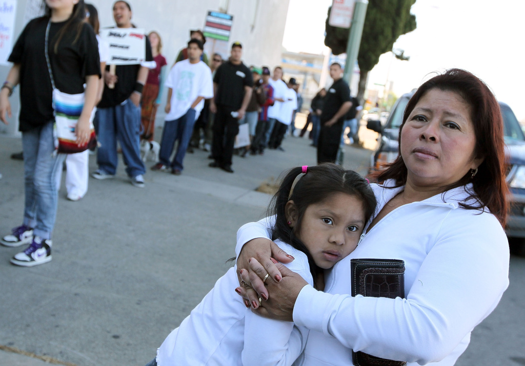 A woman embraces her child in Arizona.