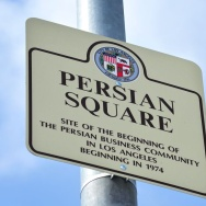 "A sign reading ""Persian Square"" overlook"