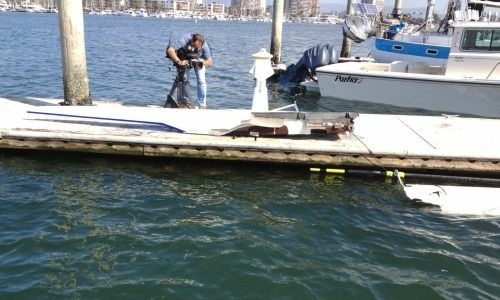 Authorities photograph a vessel that was completely destroyed in a collision with another boat in the Marina Del Rey Main Channel on Sunday, May 27, 2012.