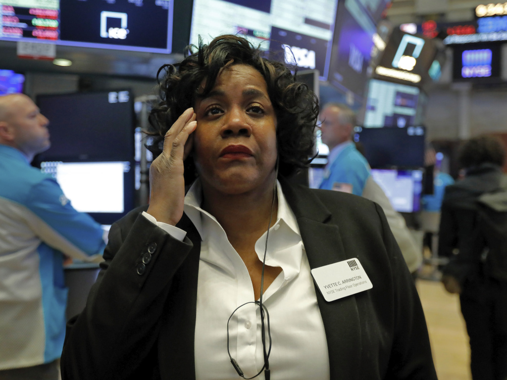 Yvette Arrington, with the New York Stock Exchange Trading Floor Operations, watches the market slide on March 9, as coronavirus fears grip the financial markets.