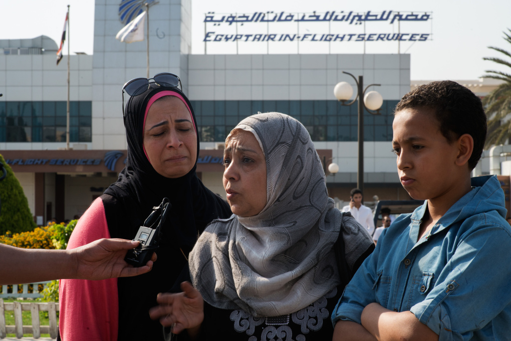 Mervit Mounir (L), and Answar Moissen, talk with journalists in front of the Egypt Air In flight services building where family and friends of the Egypt Air flight are gathering on in Cairo, Egypt. Their relative was on the plan, they last talked with her when she was recently married.