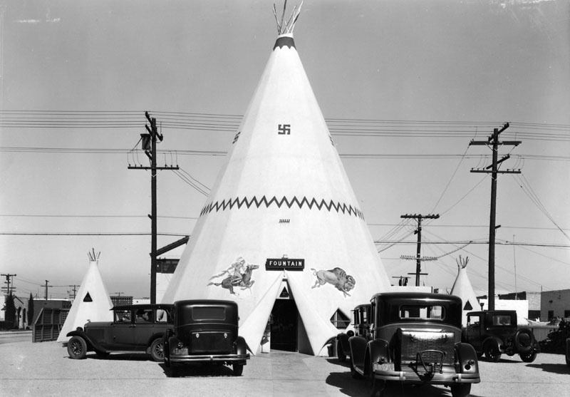 The Teepee was a popular ice cream stand in Long Beach on 2nd St. at Covina Ave, 1931. During this time, the swastika was commonly displayed as a positive symbol before the Nazi Party adopted it and gave it its hateful connotations. (Photo via Los Angeles Public Library Collection)