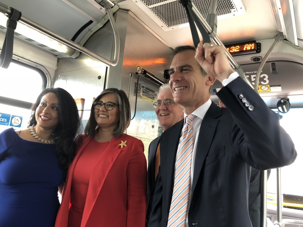 Los Angeles Mayor Eric Garcetti and other officials ride an Orange Line bus on June 29, 2018 covering the route that the new San Fernando Valley light rail will take.