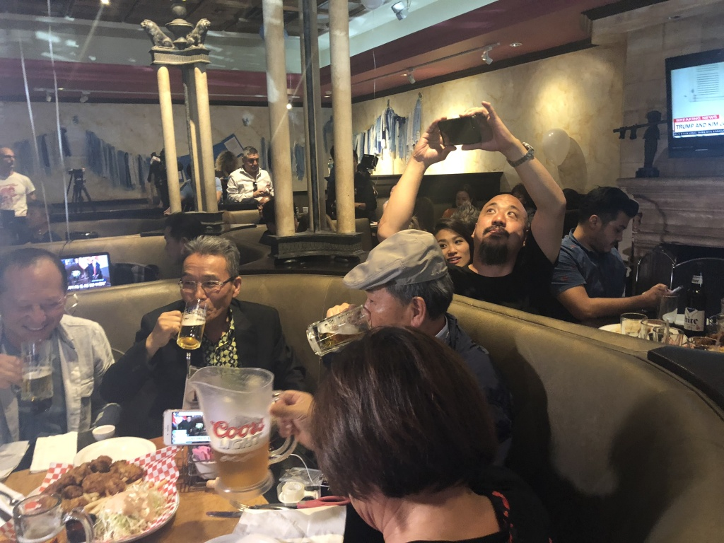 Korean Americans watched the historic meeting between President Trump and North Korea's Kim Jong Un at a restaurant in Koreatown Monday night.