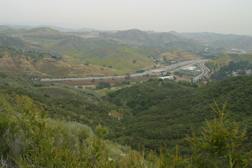 Wildlife experts are pushing for a crossing for mountain lions near the Liberty Canyon exit on the 101 Freeway, seen here. Roads, particularly freeways, are one of the major challenges to the long-term survival of mountain lions in the Santa Monica Mountains, and a crossing here would connect terrain to the north.