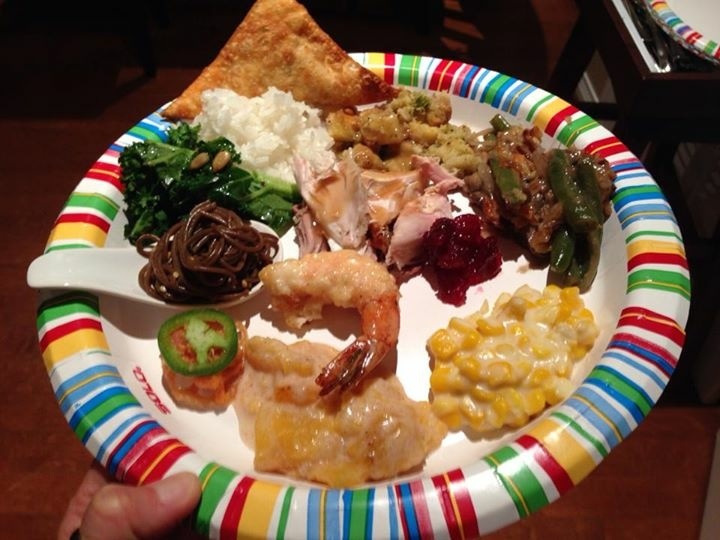 A holiday plate featuring Brazilian, Korean, Japanese, Chinese, and traditional American Thanksgiving food made by many moms.