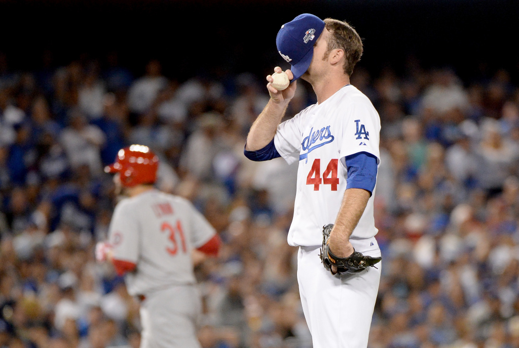 Pitcher Chris Withrow #44 of the Los Angeles Dodgers reacts after he is called for a balk in the fifth inning against the St. Louis Cardinals in Game Four of the National League Championship Series at Dodger Stadium on October 15, 2013 in Los Angeles, California.