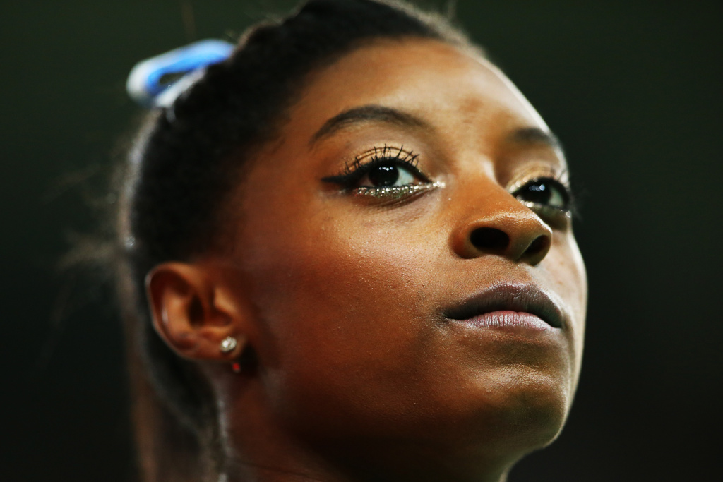 Simone Biles of the United States looks on during the Women's Individual All Around Final on Day 6 of the 2016 Rio Olympics at Rio Olympic Arena on August 11, 2016 in Rio de Janeiro, Brazil.