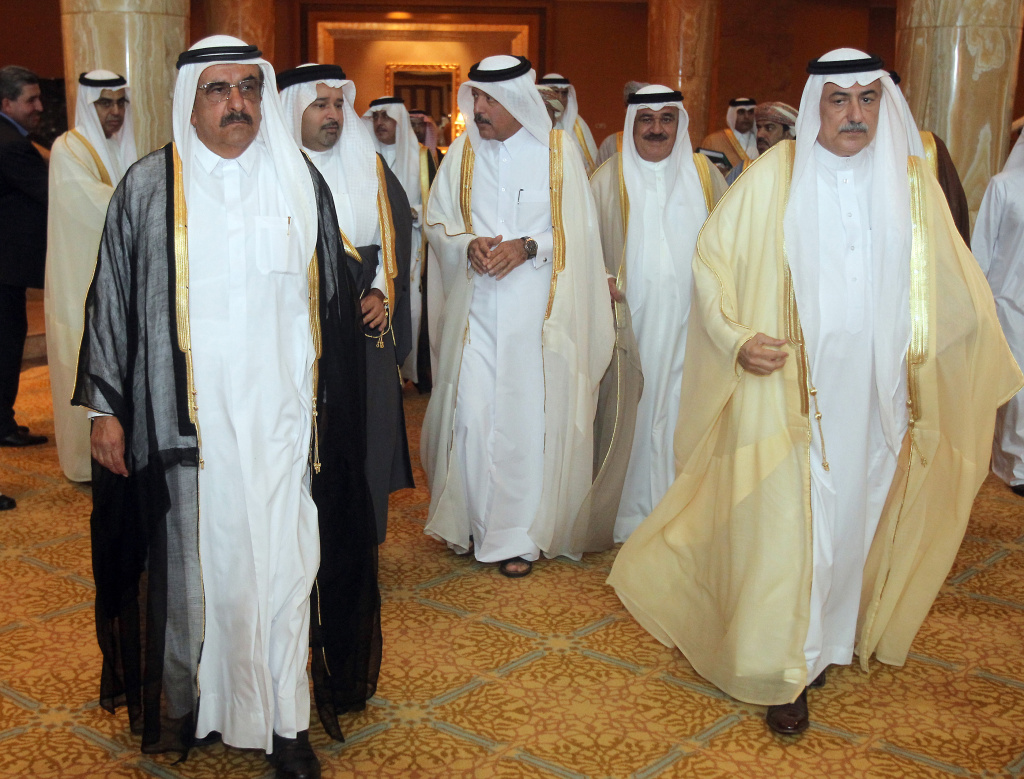 Saudi Finance Minister Ibrahim al-Assaf (R) and Emirati Finance and Industry Minister Hamdan bin Rashed al-Maktoum (L) arrive with aides to attend a meeting of finance ministers of oil-producing Gulf Cooperation Council monarchies focusing on economic development projects in the region, in the Emirati capital Abu Dhabi on May 7, 2011.