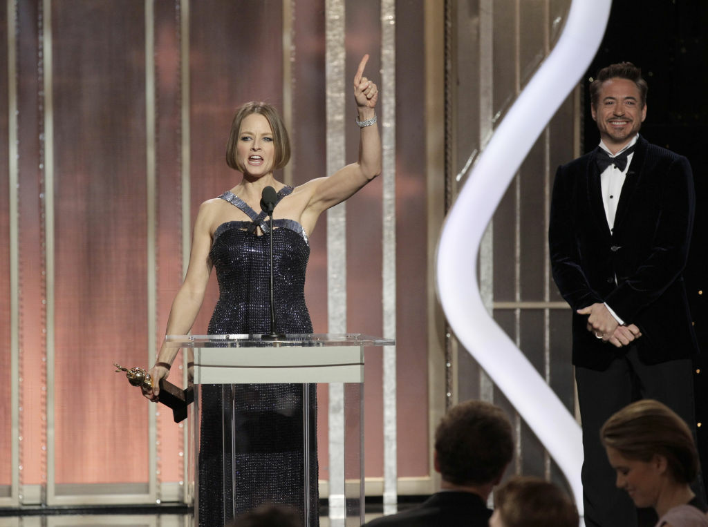 Actress Jodie Foster receives the Cecil B. Demille Award from Robert Downey Jr. on stage during the 70th Annual Golden Globe Awards at the Beverly Hilton Hotel International Ballroom on Jan. 13, 2013 in Beverly Hills.