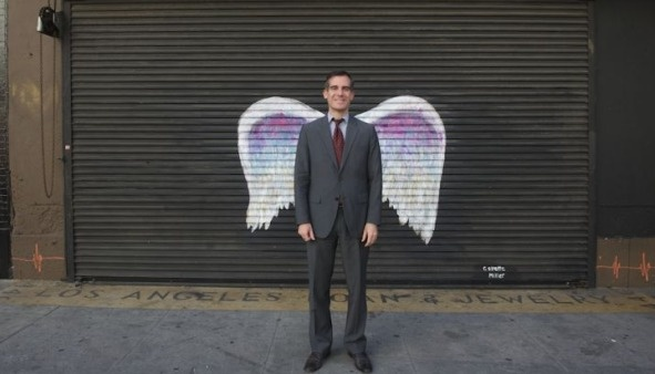 LA Mayor Eric Garcetti with Collette Miller's wings.