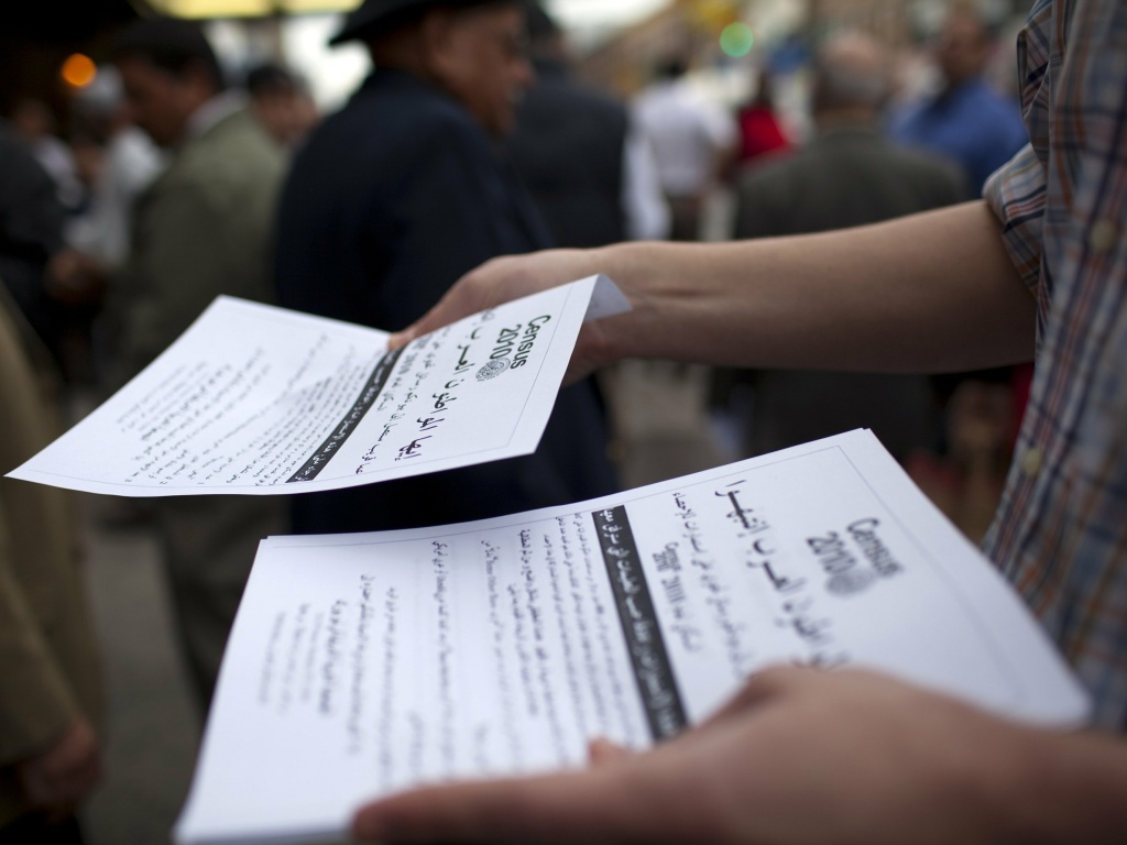 Worshippers exiting a mosque in the Bay Ridge neighborhood of Brooklyn, N.Y., are handed fliers encouraging participation in the 2010 census.