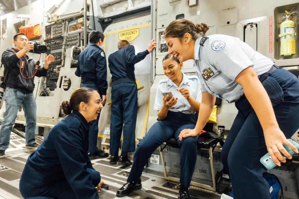 (Left to right) Air Force Junior Reserve Officer Training Corps cadets Alma Del Muro, Sativa Dale and Madison Cote of Canyon Springs High School steady themselves during a bumpy part of the flight.