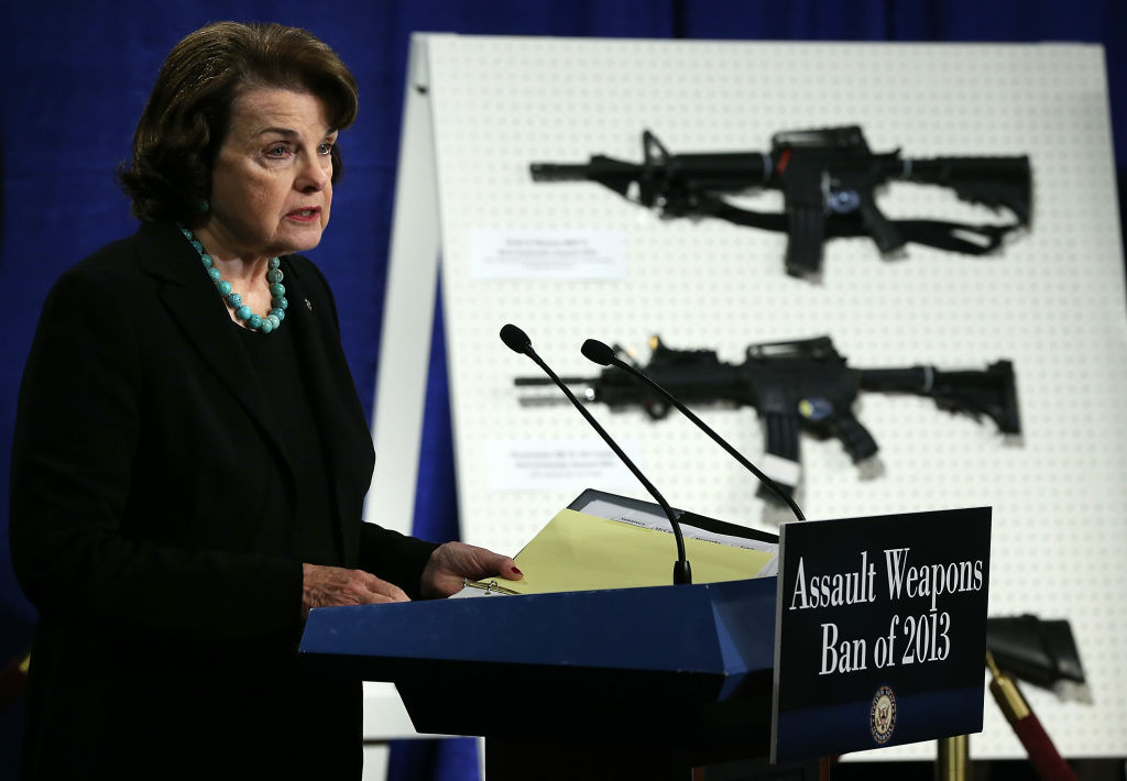 U.S. Senator Dianne Feinstein (D-CA) speaks next to a display of assault weapons during a news conference January 24, 2013 on Capitol Hill in Washington, DC. Feinstein announced that she will introduce a bill to ban assault weapons and high-capacity magazines capable of holding more than 10 rounds to help to stop gun violence.