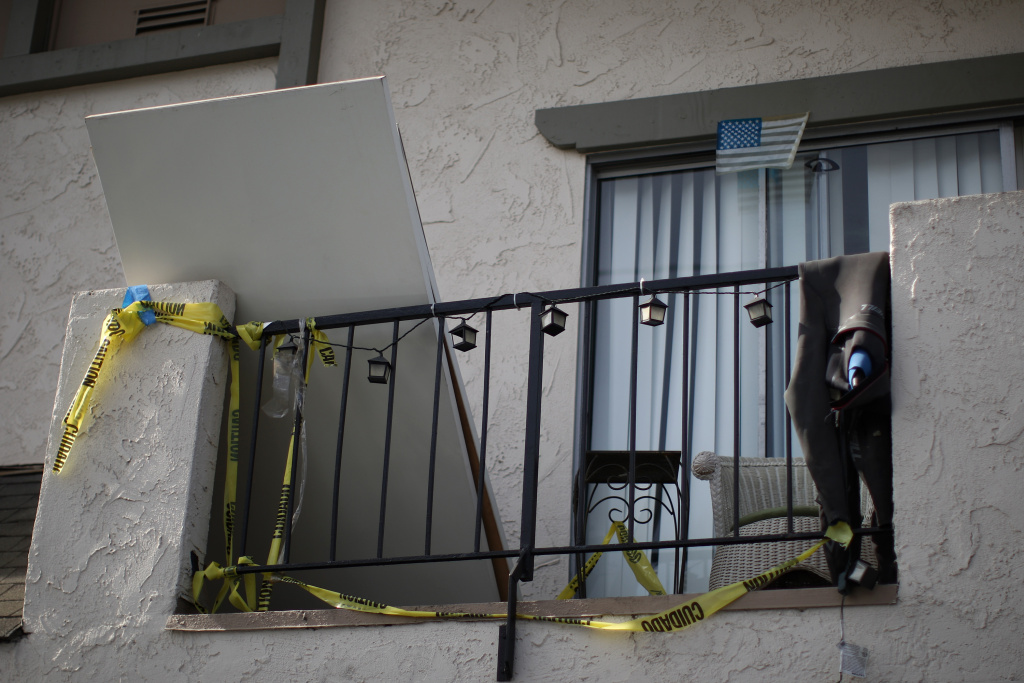 Crime scene tape hangs from an apartment balcony at a shooting site on Del Playa Drive May 25, 2014 in Isla Vista, California.