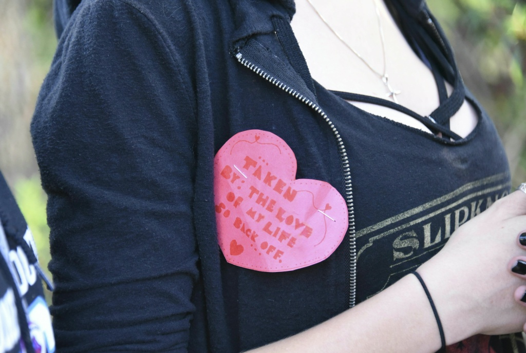 A student wears a Valentine's pin as she leaves Marjory Stoneman Douglas High School in Parkland, Florida, a city about 50 miles north of Miami on Feb. 14, 2018 following a school shooting.