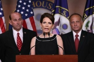 U.S. Rep. Louie Gohmert (R-TX), (L) and U.S. Rep. Steve King (R-IA) (R) look on as Republican presidential candidate and U.S. Rep. Michele Bachmann (R-MN) speaks at a news conference at the U.S. Capitol July 13, 2011 in Washington, DC. Gohmert, Bachmann and King spoke on legislation regarding the debt ceiling and military benefits.