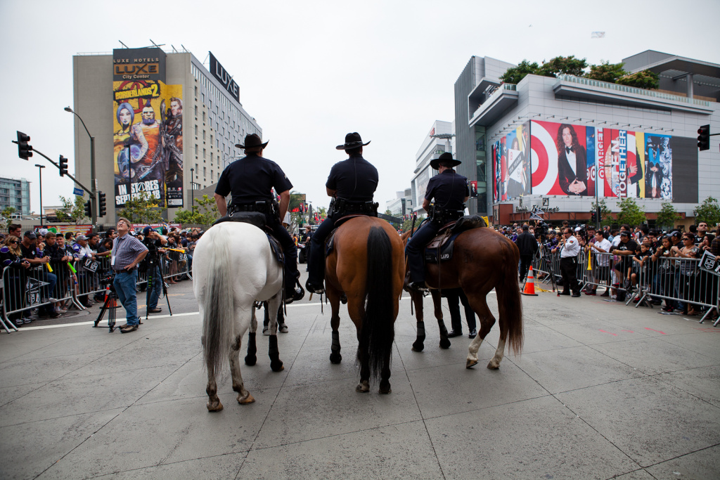 Mounted police keep an eye on the crowd just before the LA Kings arrived during their parade.