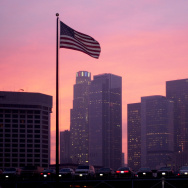 395716 05: An American flag flies at sunset October 11, 2001 in downtown Los Angeles as the city is placed on highest alert after the F.B.I. warned of a possible terrorist attack in the near future.