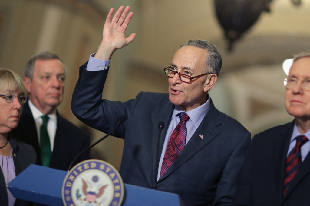 File: Sen. Charles Schumer (D-NY) answers reporters' questions at a news conference on Tuesday, Dec. 8, 2015. Democrats are trying to draw attention to their push to prevent suspected violent extremists from obtaining guns.